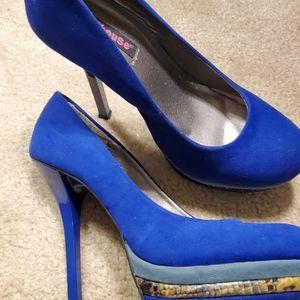 Blue platform heels in great condition.